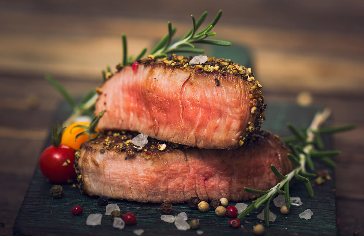 black pepper crusted steak sliced in half illustrates one of the powerful vitamin combinations