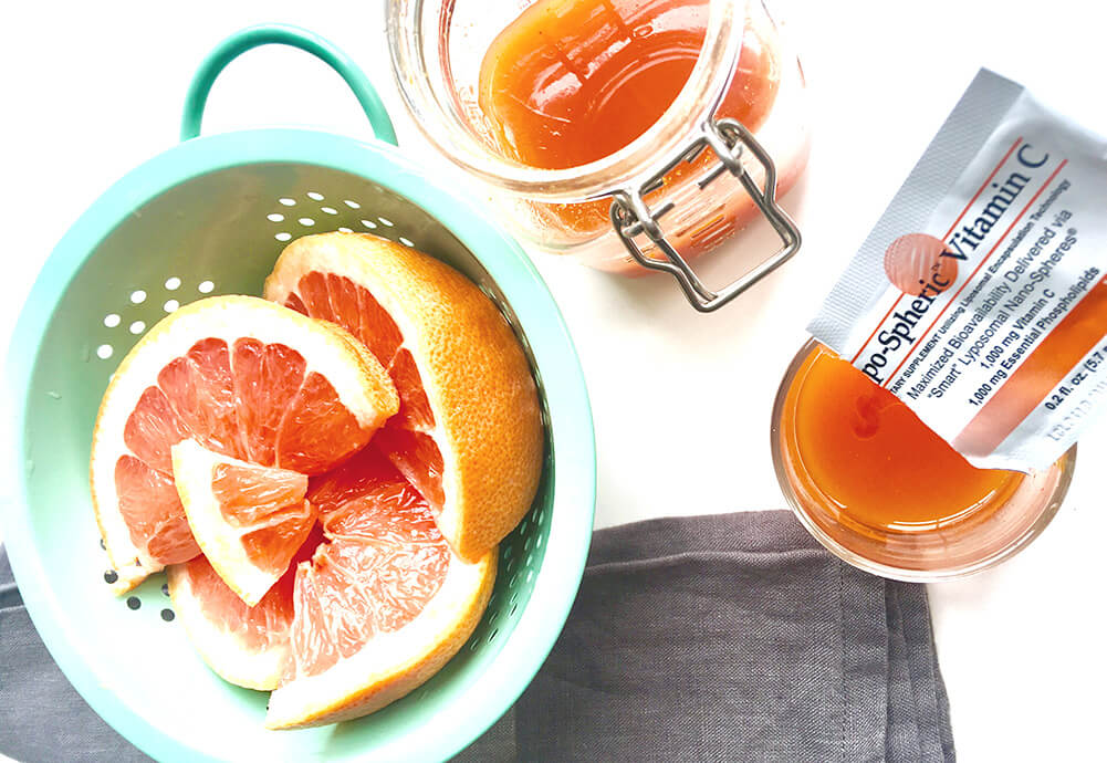 squeezing lypo-spheric vitamin c into the summer skin juice shot