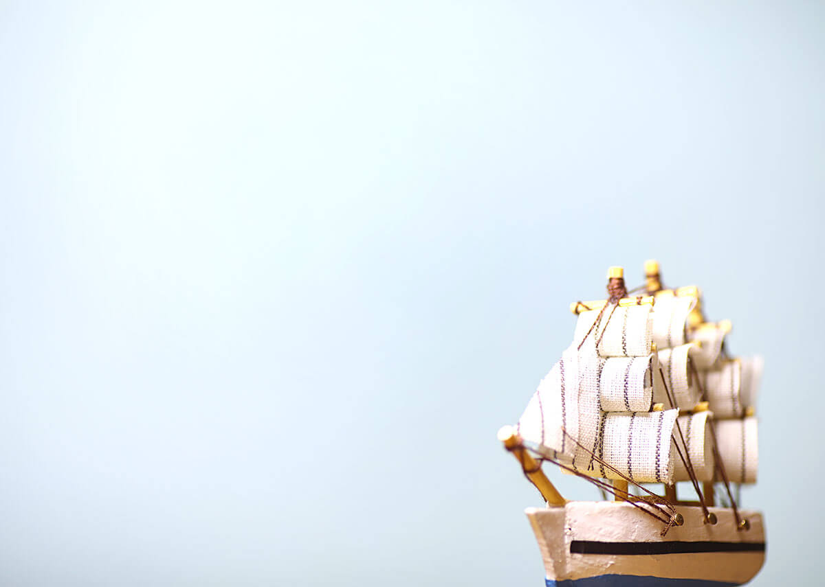 pirate ship on a blue background, a likely place to experience scurvy symptoms