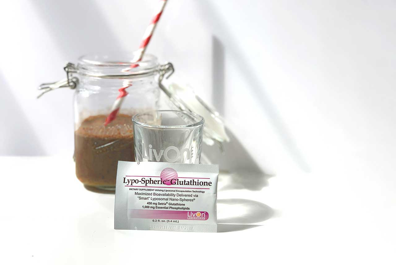 forever young drink in a mason jar with a packet of lypo-spheric glutathione