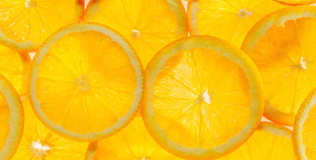 Slice of a fresh juicy orange round orange