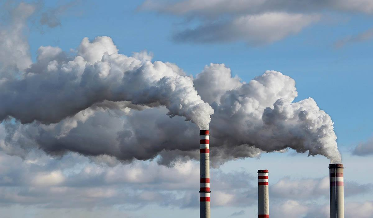 factory smoke stacks release air pollution that can cause free radicals
