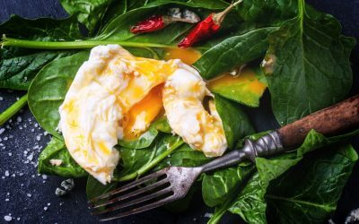 fried egg on spinach contains many of the b complex benefits