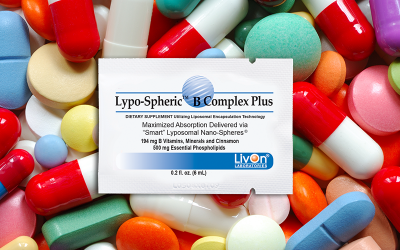 Lypo-Spheric B Complex Plus packet on top of an assortment of pills