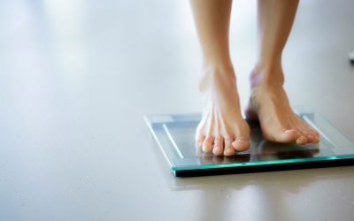 bare feet on bathroom scale illustrates acetyl l-carnitine for weight loss