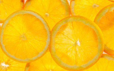 Slice of a fresh juicy orange round orange