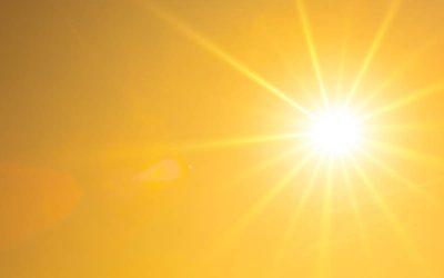 Summer background, orange sky with glowing sun
