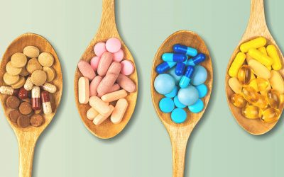 vitamin pills on wooden spoons