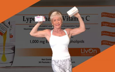 Iris Davis posing with cartons of LivOn products